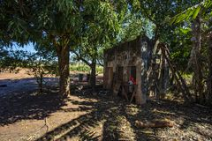 Old abandoned house in the countryside with broken roof. Brazil. South America stock photo