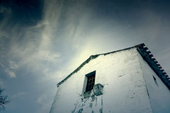 Old abandoned house. Detail of an old house with sky Royalty Free Stock Image