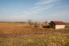 Old abandoned house in a field and blue sky Royalty Free Stock Photography