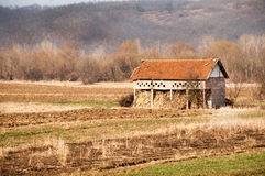 Old abandoned house in a field and blue sky Royalty Free Stock Image
