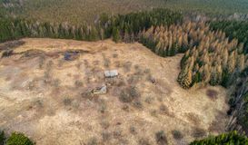 Old abandoned house in forest. Aerial drone photo stock photography