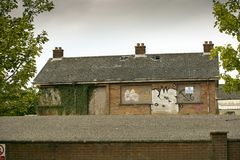 The old house. An old abandoned house with graffiti Stock Photo