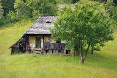 Old abandoned country house. Summer landscape Stock Photos