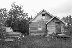 Old abandoned house with old truck sitting nearby. Stock Images