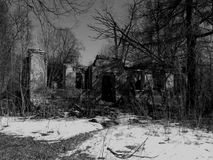Old abandoned house in ruins on a black and white photos Royalty Free Stock Photo