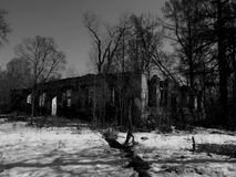 Old abandoned house in ruins on a black and white photos Stock Photography