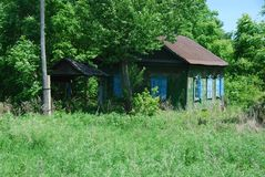 Оld abandoned house in a Russian village. House village accommodation farm farmer summer abandoned uninhabited rustic wooden family father traditional russian Royalty Free Stock Images