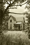 Old, Abandoned House in Sepia. An old, abandoned Lockmaster's house, shot in a sepia tone, with no trespassing sign stock images