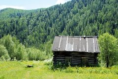 Old abandoned house in the Siberian village. Sayan. Siberia. Stock Photography