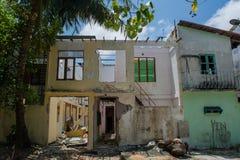 Old abandoned house at the street of Villingili island Royalty Free Stock Image