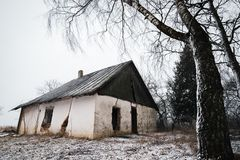 Old abandoned house in winter time. Lithuania Stock Photo