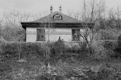 Old abandoned house. In the wood, white black photo Stock Images