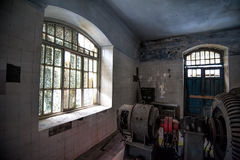 Old abandoned hydro power plant machine hall interior in Abkhazia Royalty Free Stock Image