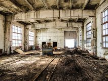 Old abandoned industrial building. Wet, mold damaged, dilapidated reinforced concrete building structures. Old abandoned industrial building. Wet, mold damaged stock image