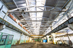 Old abandoned industrial factory warehouse at sunny day Royalty Free Stock Image