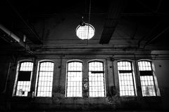 Old Abandoned industrial interior. With bright light Stock Photography