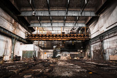 Old Abandoned industrial interior with bright light Stock Photo