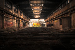 Old Abandoned industrial interior with bright light Stock Image