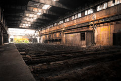 Old Abandoned industrial interior with bright light Stock Photos