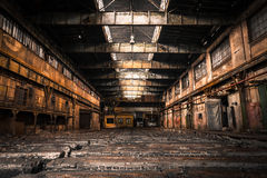 Old Abandoned industrial interior with bright light royalty free stock photo