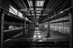Old abandoned industrial interior. Bright light Stock Photo