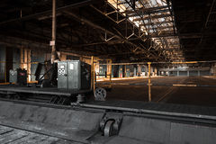 Old abandoned industrial interior. Bright light Royalty Free Stock Photos