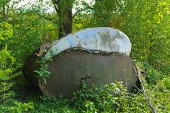 Old abandoned iron rusty tanks and metal structures. The crisis, the collapse of the economy, the cessation of production. Capacity, led to a collapse. The royalty free stock photography