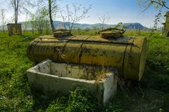 Old abandoned iron rusty tanks and metal structures. The crisis, the collapse of the economy, the cessation of production. Capacity, led to a collapse. The royalty free stock photos