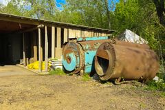 Old abandoned iron rusty tanks and metal structures. The crisis, the collapse of the economy, the cessation of production. Capacity, led to a collapse. The royalty free stock photo