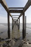 An old and abandoned jetty. Facing straight to the sea Royalty Free Stock Images