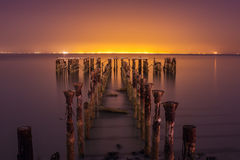 Old abandoned jetty pier with vibrance colour Royalty Free Stock Photo