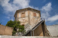 Old abandoned landmark. Close up view of old abandoned landmark, called Tower of the vegetable garden of the dogs, located in Faro city, Portugal royalty free stock image