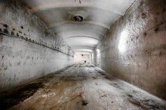 An old abandoned limestone mine corridors. Poor light stock photography
