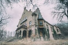 Old abandoned mansion in mystic spooky forest Royalty Free Stock Images