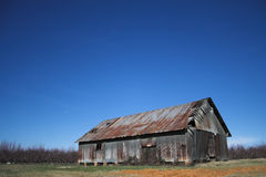 Old Abandoned Metal Barn. In rural South Carolina with blue sky stock photo