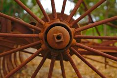 old abandoned metal wheel of farm machinery from 19th century stock images