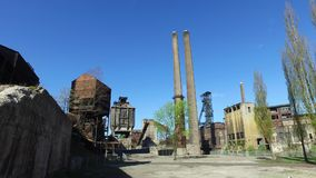 Old Abandoned Metallurgical Plant - Coke plant, chimneys, coal mine tower.