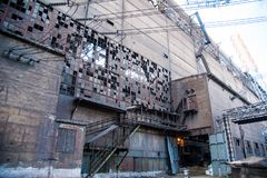 Old abandoned metallurgical plant. Metal structures and buildings of the old metallurgical plant inside and outside stock image