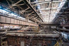 Old abandoned metallurgical plant. Metal structures and buildings of the old metallurgical plant inside and outside royalty free stock images