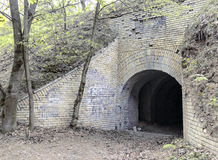 Old abandoned military fort in the forest. Cave, tunnel, old, abandoned, military fort in the woods, park for walks, spring, sunny day, mysticism, magic stock images