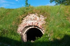Old abandoned monastery cellar. Overgrown with grass royalty free stock photos