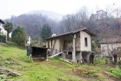 Old abandoned mountain farm near Lugano. City in Switzerland royalty free stock photo