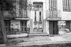 Old abandoned, neoclassical house. Black & white photo of an old, abandoned, neoclassical house, Piraeus - Greece stock image
