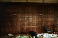 Old abandoned office 70`s style wooden wall is left rotting for ages!. Interior of an abandoned castle wich has been left there for years now! No work will ever stock photography