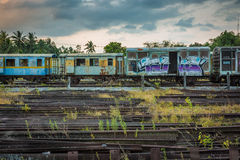 Old and abandoned passenger train. Train cemetery Thailand  Old and abandoned passenger train Royalty Free Stock Photography