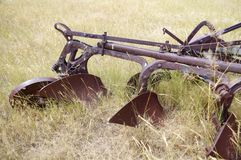 Old abandoned plow. You can see three of the blades Stock Photography