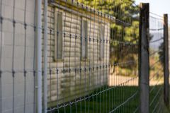 Old Prison Fence. Old abandoned Prison Site, walls, wire and cameras gathering dust royalty free stock photo