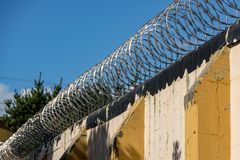Old Prison Razor Wire. Old abandoned Prison Site, walls, wire and cameras gathering dust Stock Image