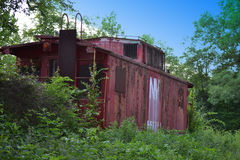 Old abandoned railroad train car. An old abandoned railroad train car in the country with old markings of days gone bye Stock Photography
