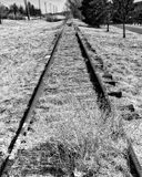 Old Abandoned Railroad Train Tracks. In Colorado Springs what was formerly the Rock Island Line in black and white stock image